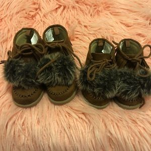 Brown lace up booties with pom poms